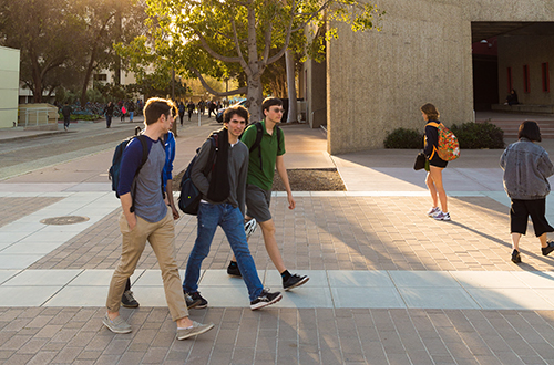 Image of a group of students walking toward their next class